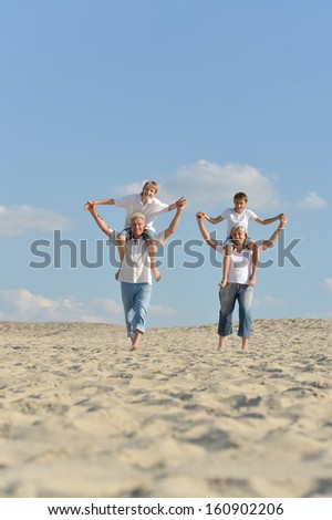 Old couple with their grandsons walking outdoors