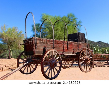 Old covered wagon from the wild west - stock photo