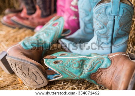 old Cowboy Boots in farm - stock photo