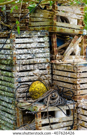 Old crab pots and a buoy - stock photo