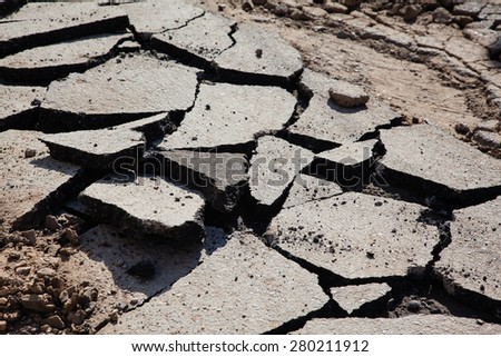 Old cracked asphalt closeup background - stock photo