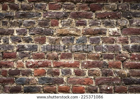 old cracked brickswall background with tawny colors