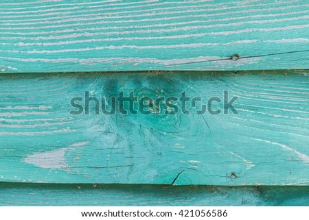 Old cracked paint on the boards