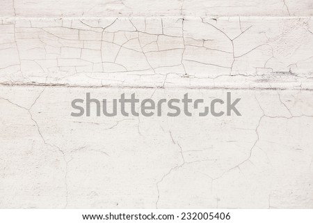 Old cracked paint on the concrete wall - stock photo