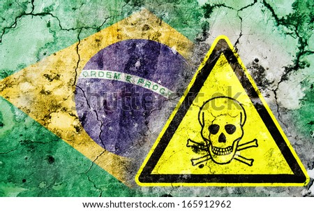 Old cracked wall with poison warning sign and painted flag, flag of Brazil
