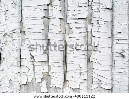 Old cracked white paint. Abstract background.