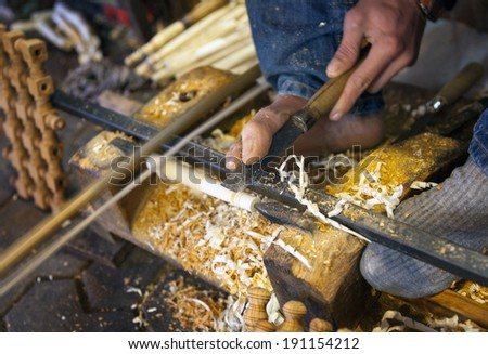 old craftsman making fife  from wood   - stock photo