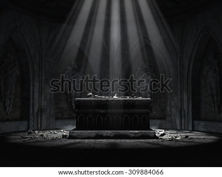 Old crypt with sculptures, an altar and skeletons lying on the floor - stock photo