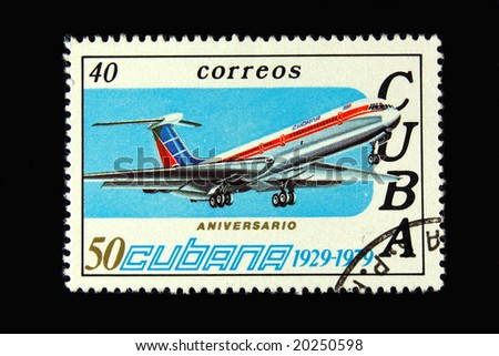 Old  Cuban postage stamp with airplane - stock photo