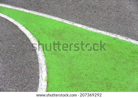 old curve texture of playground outdoor basketball court made of asphalt and painted green - stock photo