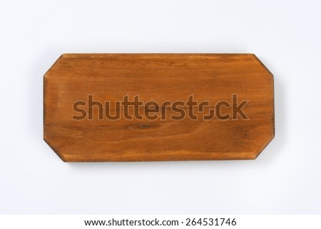 Old cutting board on white background - stock photo