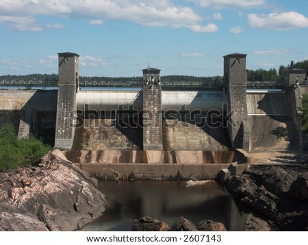 Old dam located in Finland with a high water behind it - stock photo