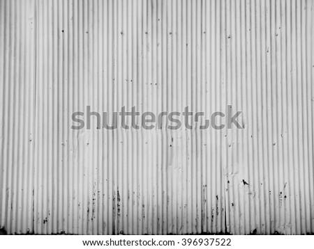 Old damage rusty zinc plat wall - stock photo