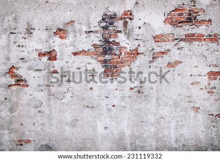 Old damaged brick wall and plaster - stock photo