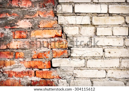 Old damaged brick wall with a crack - stock photo