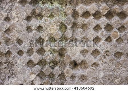 Old damaged decorative brick wall  background - stock photo