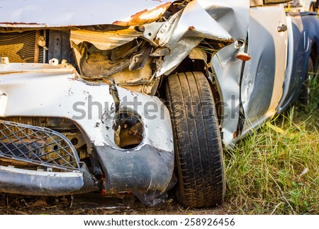Old damaged rusty car wreck  in the grass,Thailand - stock photo