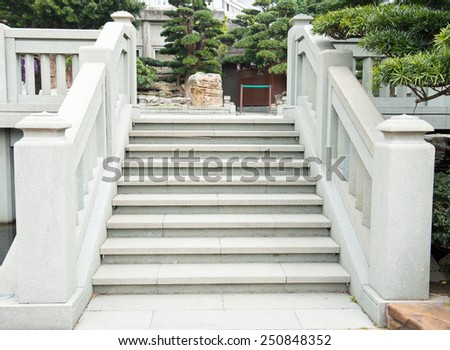 Old damaged stone staircase, up and down, textured background  - stock photo