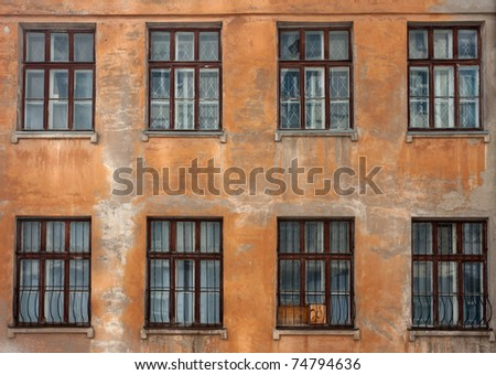 Old damaged wall with windows - stock photo