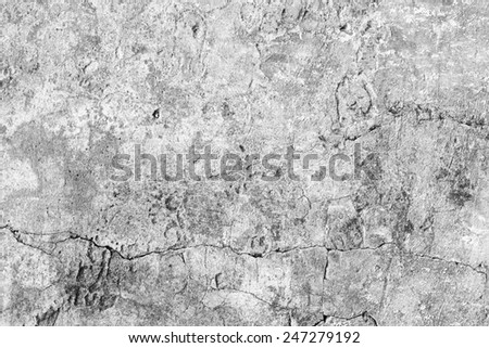 Old damaged weathered wall texture in black and white tone - stock photo