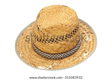 old damaged wicker hat isolated over white background