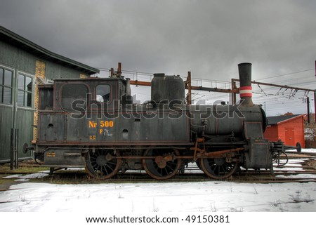Old Danish Steam locomotive in front a railway building