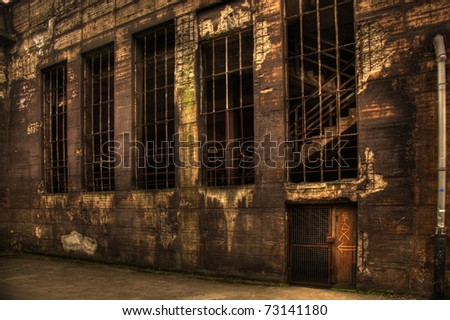 old dark abandoned building from steelfactory - stock photo