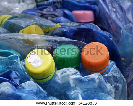 Old dark blue plastic bottles prepared for processing and recycling