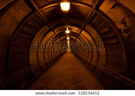 old dark red tunnel - stock photo