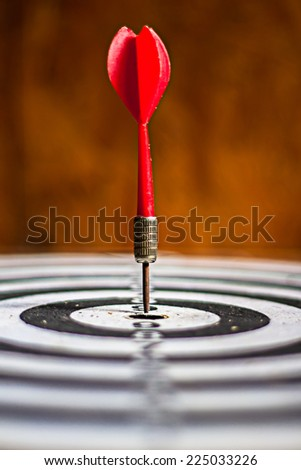 old dart target with arrows vintage color tone ,abstract background to solution concept. - stock photo