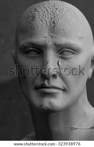 Old decaying mannequin, shot on B&W, symbol of the passage of time - stock photo