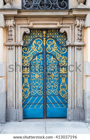 Old decorative blue doors with golden finished decorations - stock photo