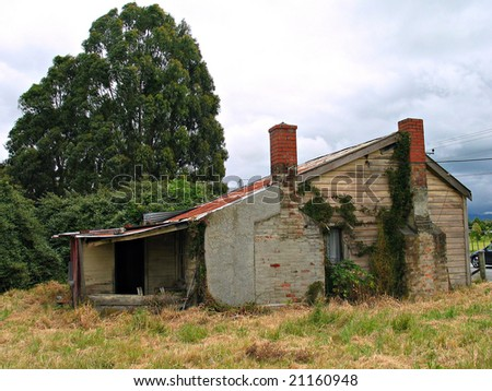 old derelict cottage-rear view - stock photo
