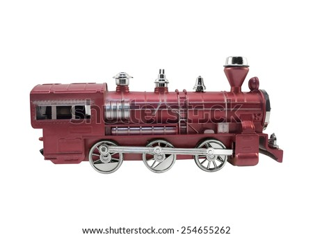 Old design train toy. Isolated red and metal colors train toy profile view. - stock photo