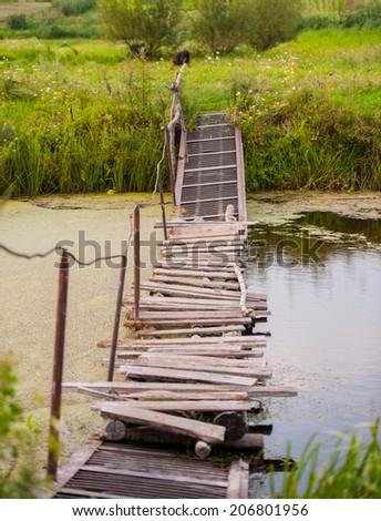 old destroyed bridge - stock photo