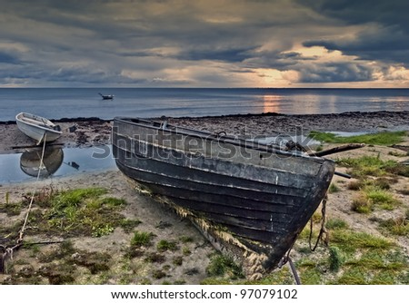 Old destroyed fishing boat - stock photo
