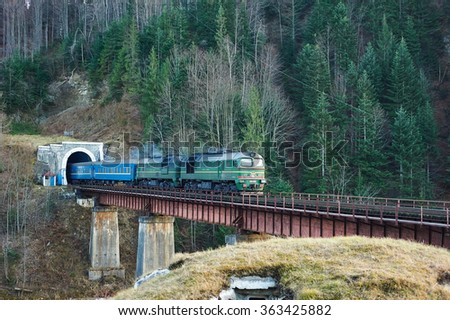 Old diesel passenger train in tunnel. Mountain railroad in Yaremche, Ukraine - stock photo
