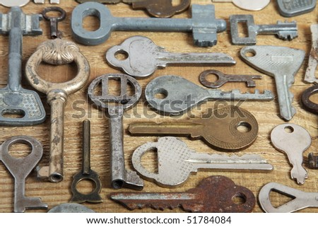 Old different keys on wood - stock photo