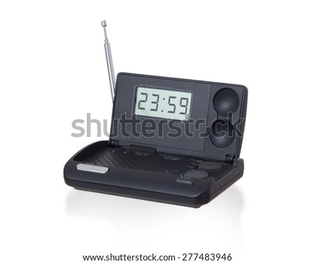 Old digital radio alarm clock isolated on white - Time is 23:59 - stock photo