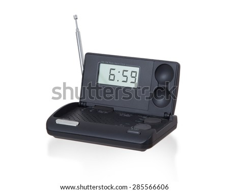 Old digital radio alarm clock isolated on white - Time is 6:59 - stock photo
