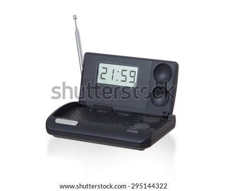 Old digital radio alarm clock isolated on white - Time is 21:59 - stock photo