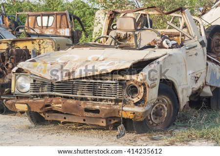 old dilapidated car - stock photo