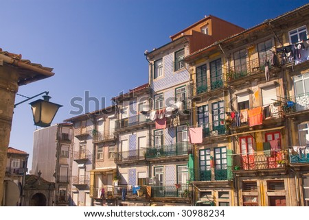 Old dilapidated houses in the old town of Porto, Portugal - stock photo