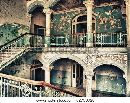 old dilapidated stairwell in the sanatorium of Beelitz - stock photo