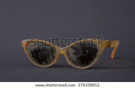 Old dirty  cat eye shaped retro sunglasses  - stock photo