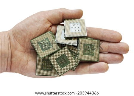 old dirty chips in hand for electronic recycling - stock photo