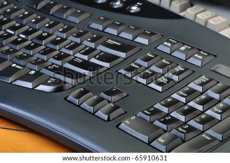 Old dirty computer keyboards in a stack - stock photo