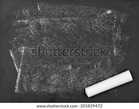 Old dirty empty chalkboard with piece of white chalk - stock photo