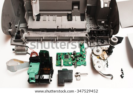 Old dirty parts of the broken ink jet printer on the white background  - stock photo