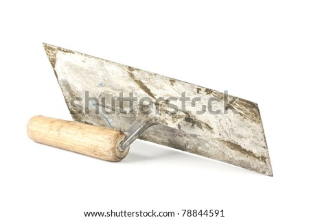 Old dirty trowel isolated on white background